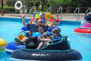 A family enjoys bumper boats at the Track in Branson, MO
