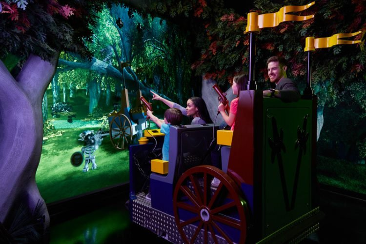 Parents and children on a ride at LEGOLAND Discovery Center Chicago