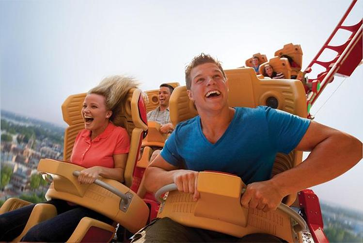 Woman and man ride a rollercoaster at Universal Orlando Resort