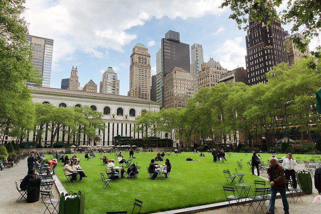 Bryant Park patrons enjoy the green space and cityscape