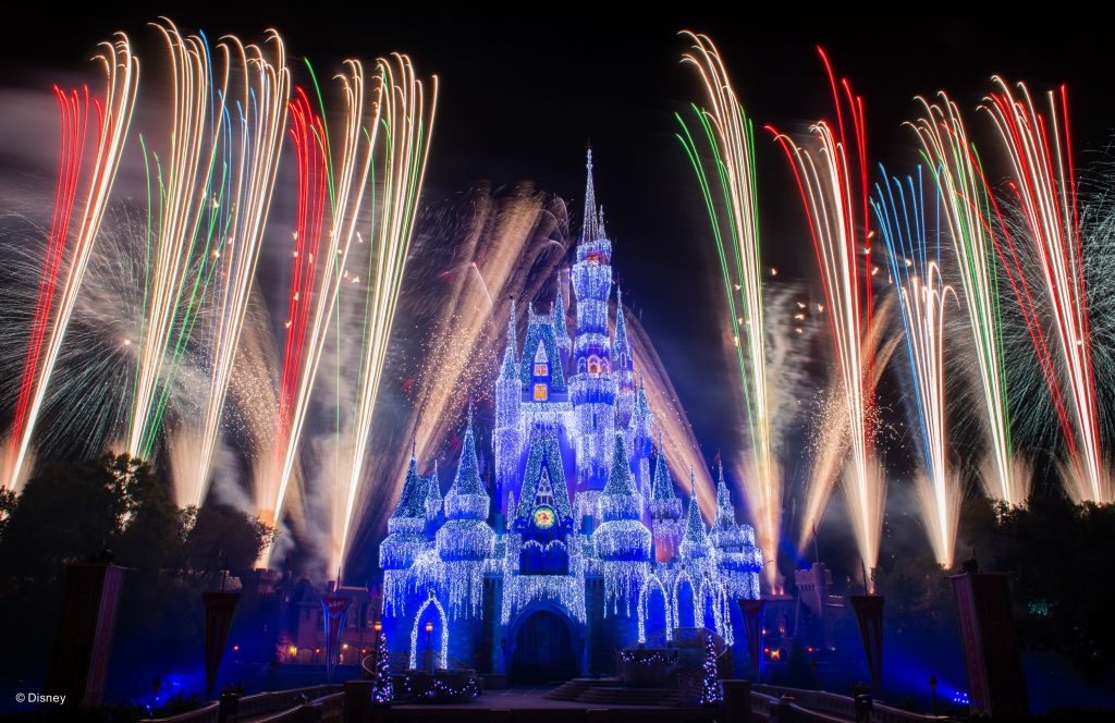 The Holiday Wishes show projection and fireworks above Cinderella's Castle at Magic Kingdom in Orlando, FL.