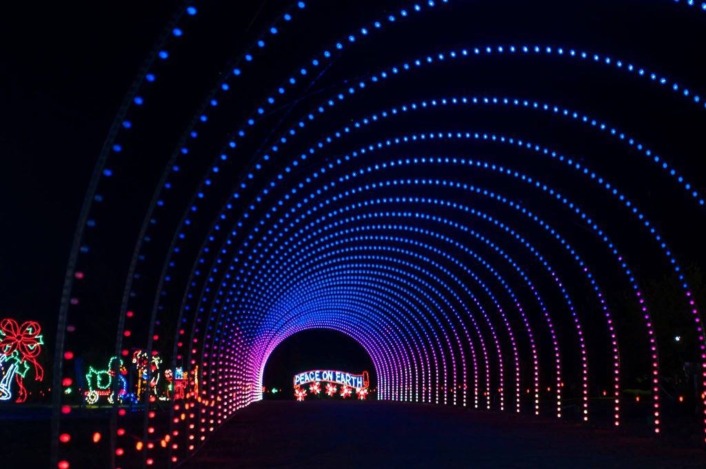 """Peace on Earth"" light display along with blue and purple lights creating a tunnel"