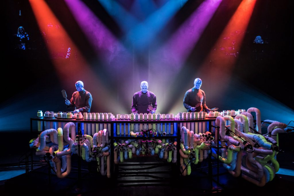 The Blue Man Group performs on their signature PVC pipe marimba instrument
