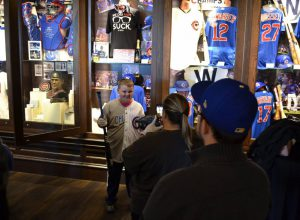 A boy stands beside the Chicago Cubs exhibit at the Chicago Sports Museum