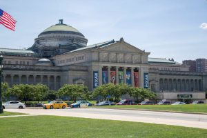 The exterior and lawn of the Museum of Science and Industry in Chicago, IL