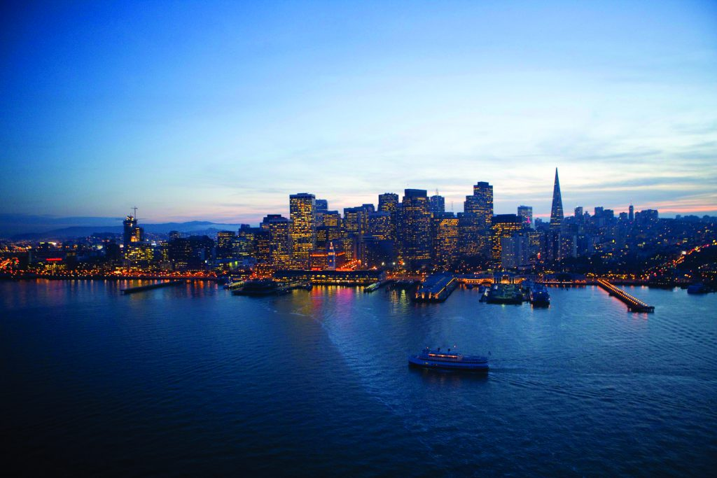 A San Francisco cruise sails by the bay at dusk