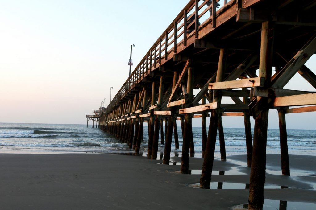 Myrtle Beach pier at sunrise with low tide