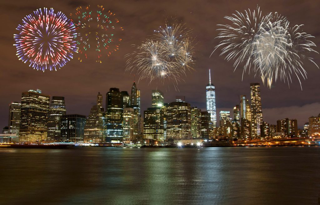 Fireworks explode over lower Manhattan on New Year's Eve