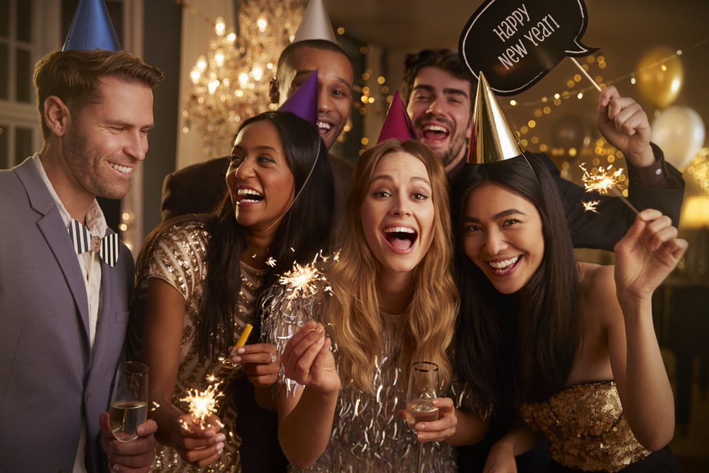 Friends celebrating at a New Year's Eve in Los Angeles party