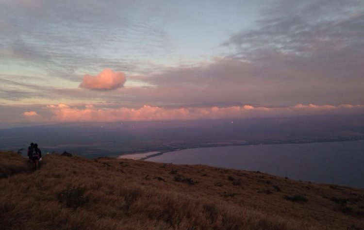 The sun sets with light purples and pinks over the Lahaina Pali Trail