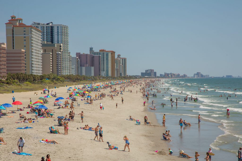Tourists flock to Myrtle Beach with beach chairs, towels, beach toys, and more