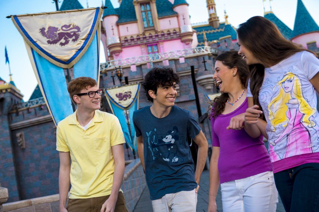 Teens stand outside of Disneyland's Sleeping Beauty Castle