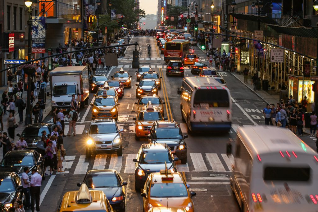 Crowded NYC streets with tourists and taxi cabs