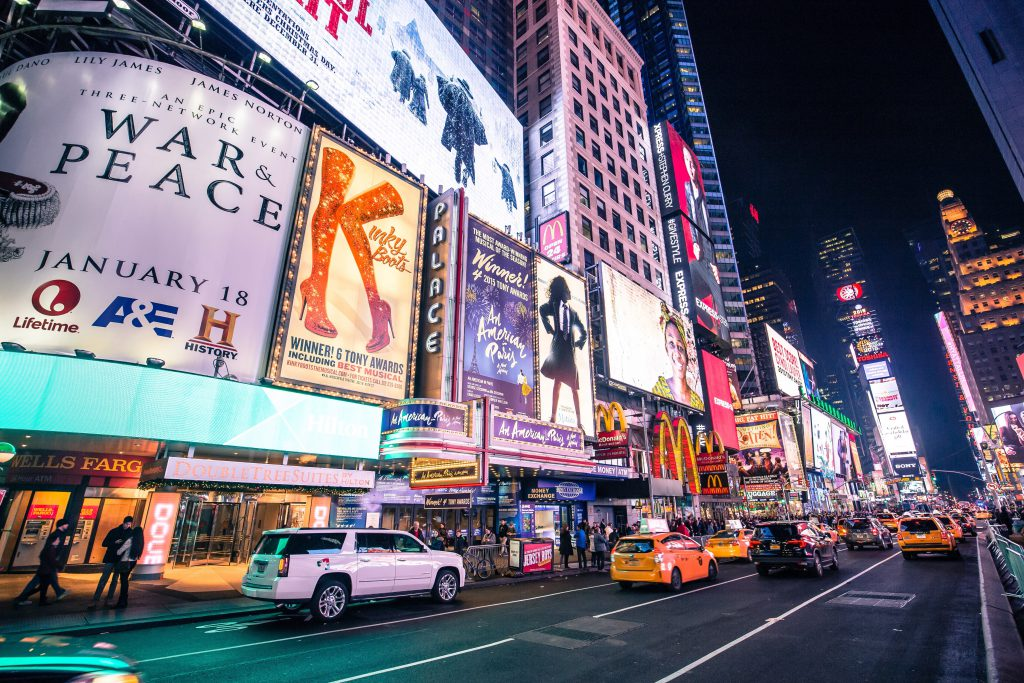 Times Square Broadway show advertisements lit up at night