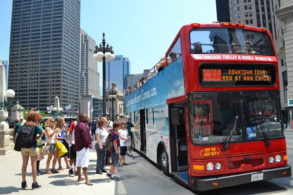 Tourists wait to board the Chicago Double Decker tour bus