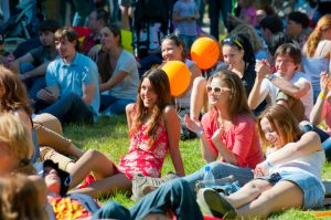 Girls attend a festival as part of the free things to do in San Diego.