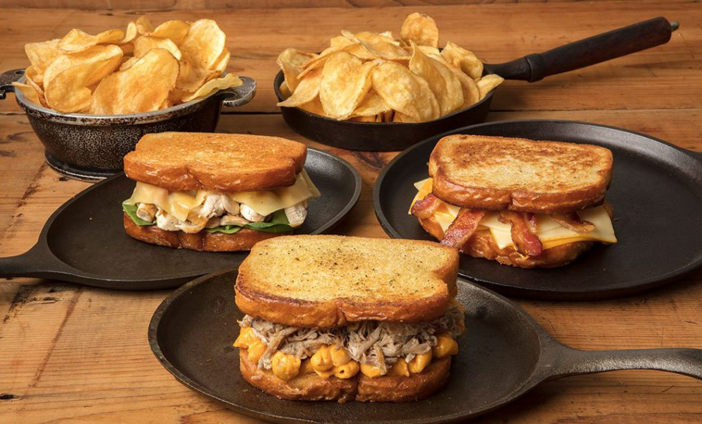 Three grilled cheese options presented on skillets at the Festival of Wonder in Silver Dollar City