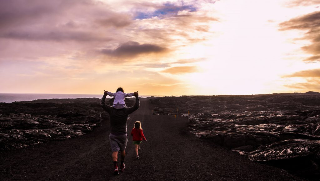 A family hikes in Hawai'i Volcanoes National Park