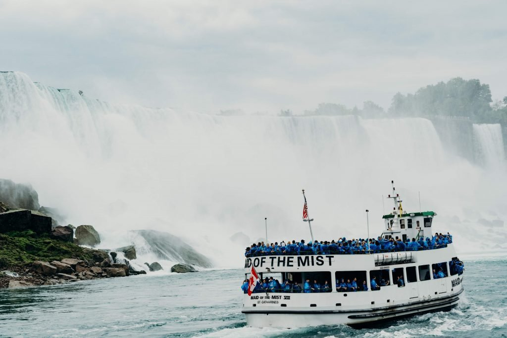 The Maid of the Mist boat tour enters the basin of one of the falls while visiting Niagara Falls