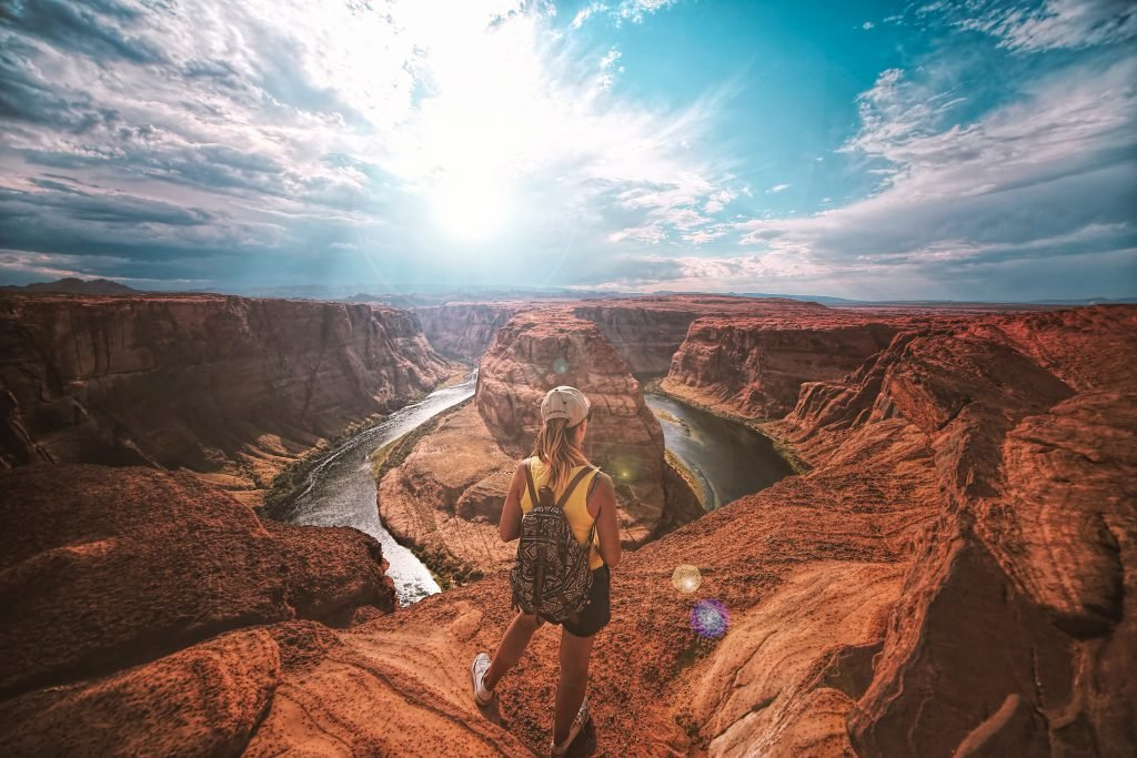 As part of the top things to do in Las Vegas during the day, a girl in a yellow tank top visits the Grand Canyon