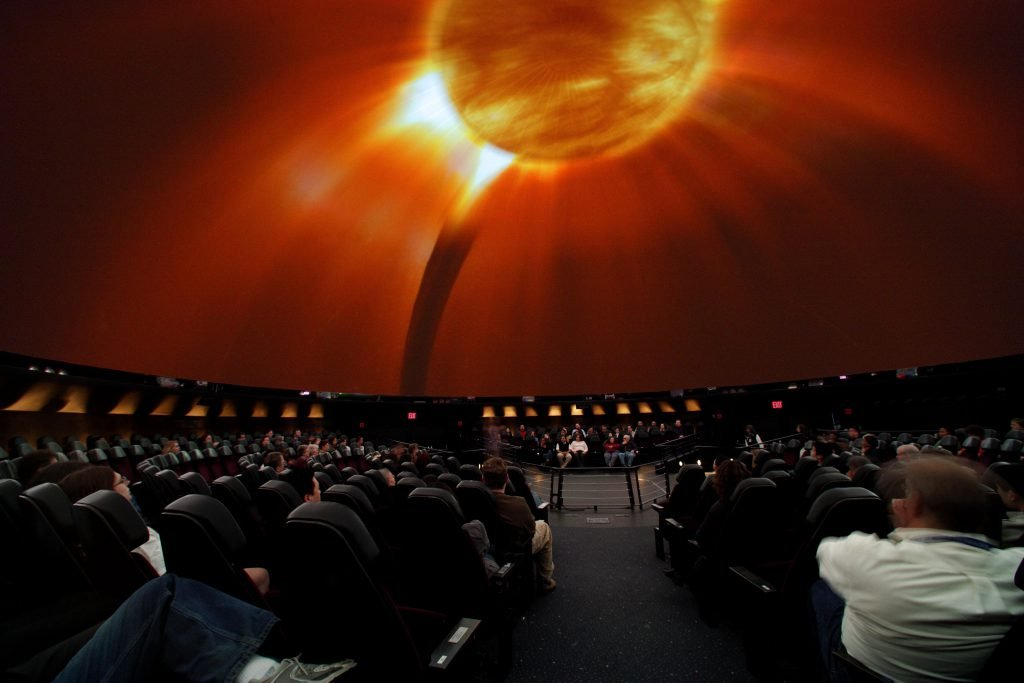 Visitors of AMNH watch a show in the Hayden Planetarium