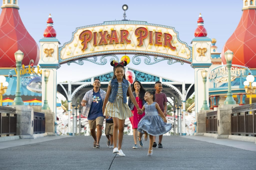 A family walks into Pixar Pier while going to Disneyland on a budget