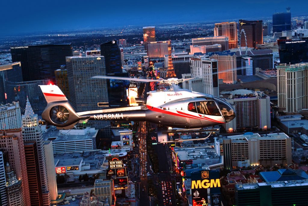 Soaring above Vegas on a helicopter is among the exciting things to do in Las Vegas for couples