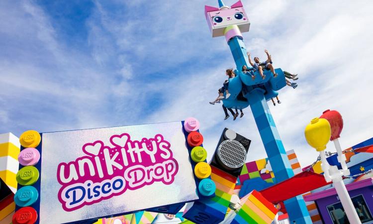 Kids ride on the new Unikitty Disco Drop ride at LEGOLAND in San Diego, California, USA